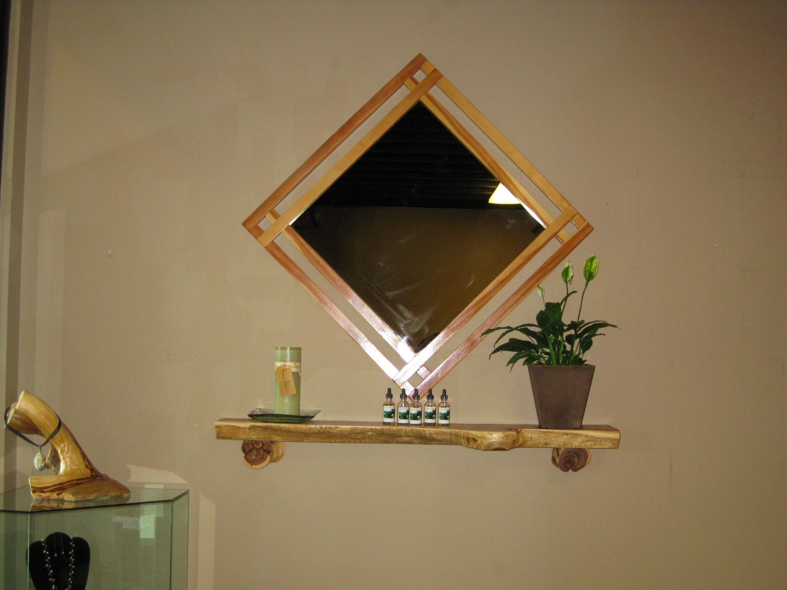 contempary juniper mirror over twisted juniper shelf