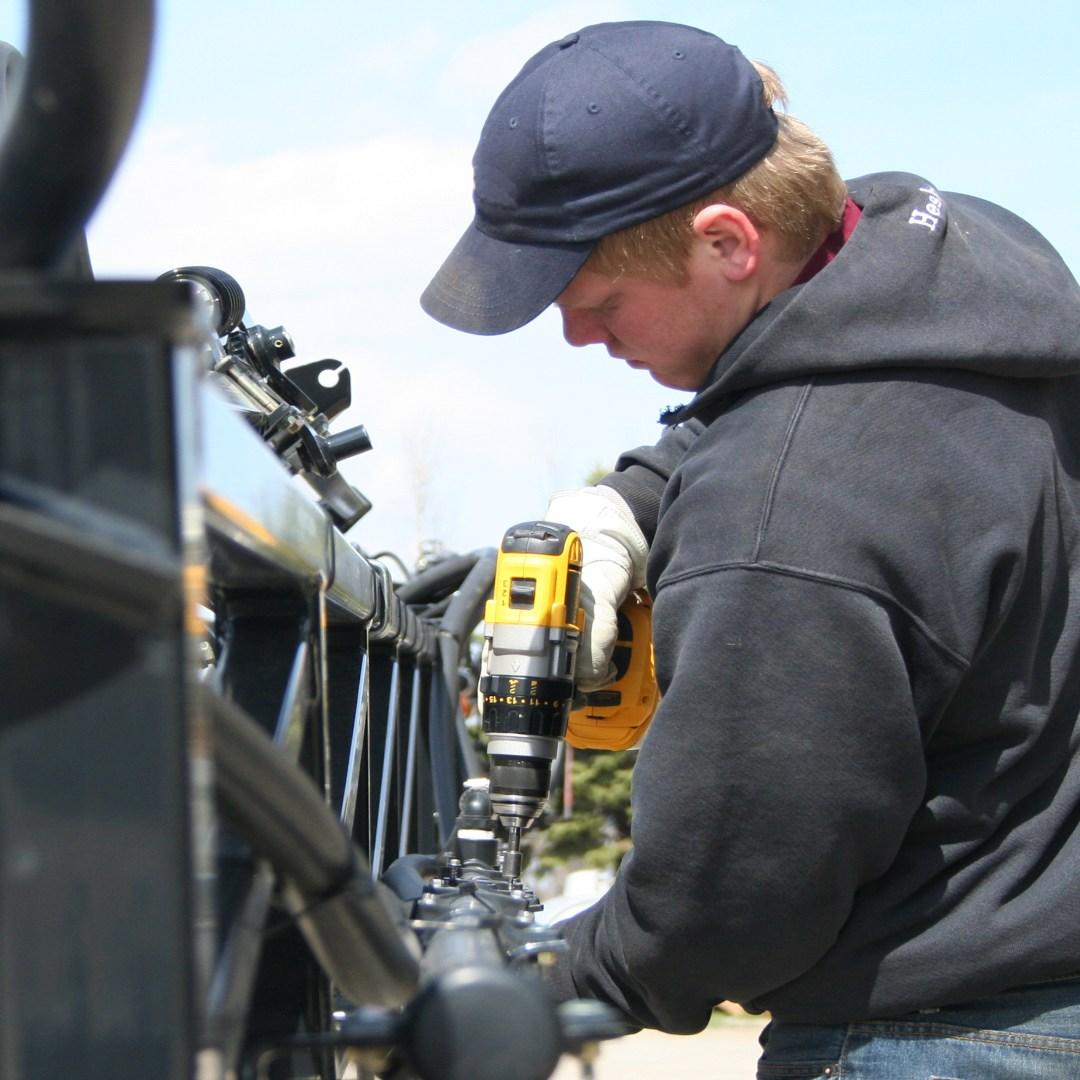 Tech working on repairing sprayer