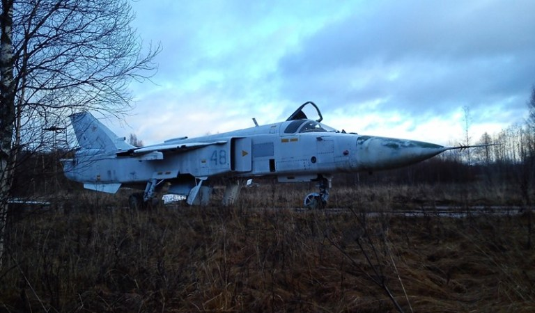 A derelict airfield and a Su-24 bomber aircraft