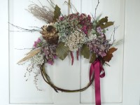 Wicker wreath with pink hydrangea, artichoke and birch