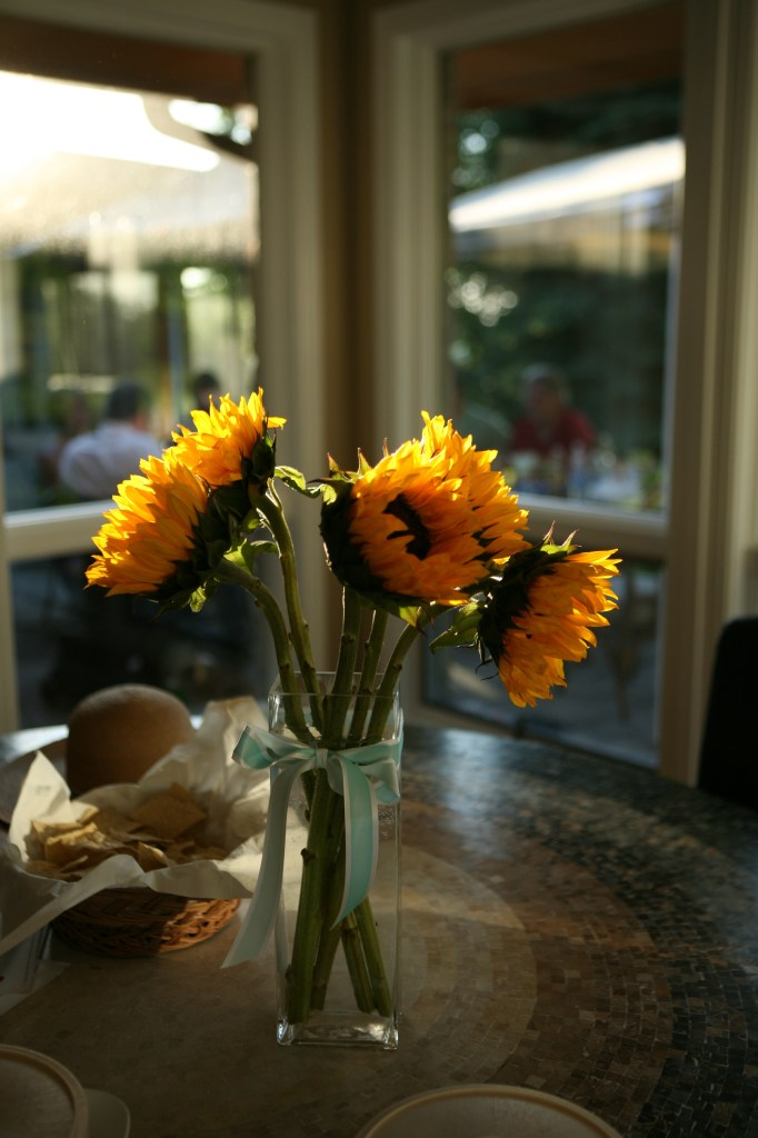 Sunflower centerpiece at Leah's house, late afternoon sun on