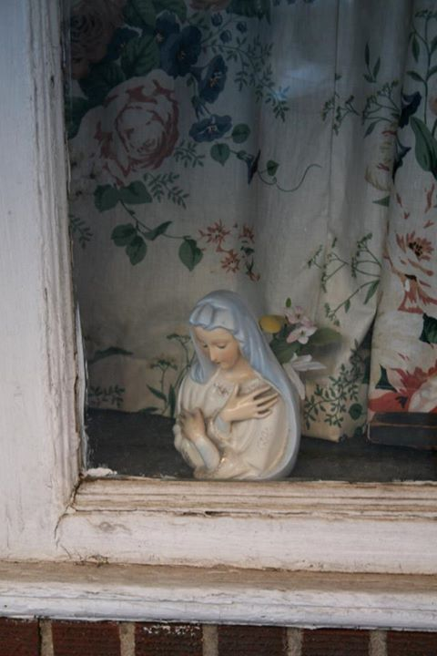 Urban Madonna in Window