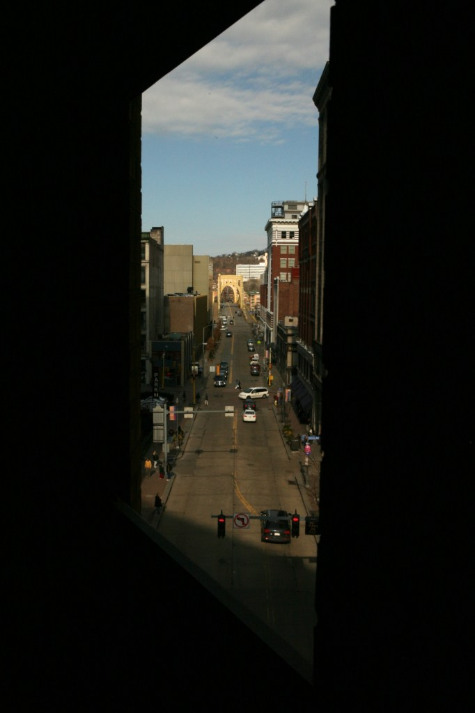 9th street bridge through a parking lot window