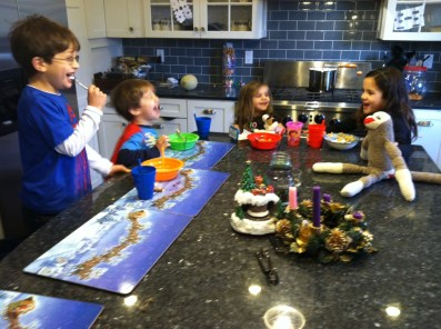 Anna entertains her siblings in the kitchen