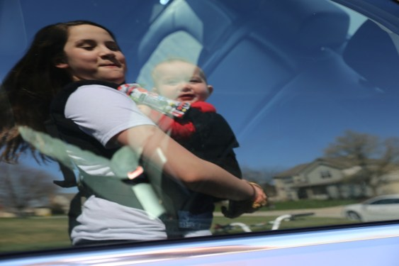 anna and charles in a car window