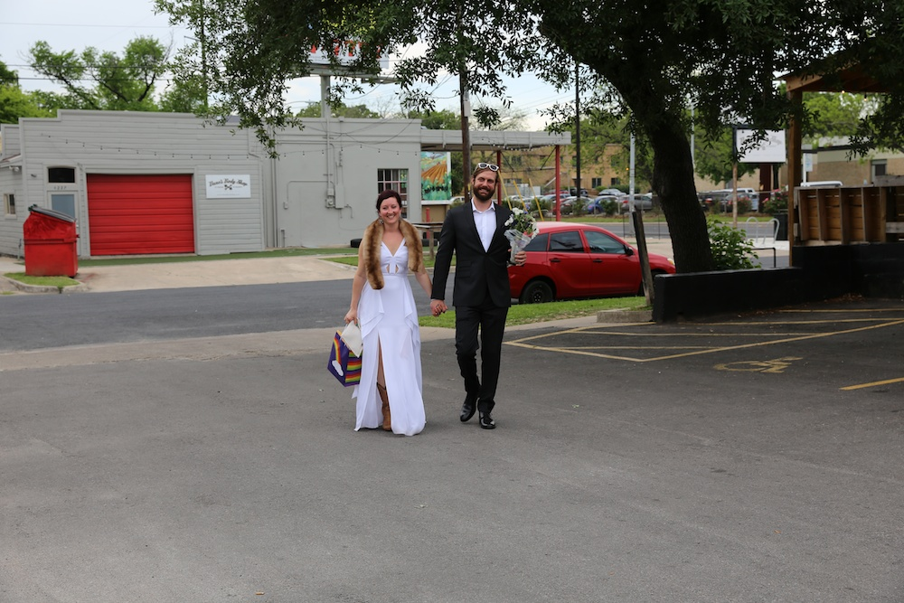 bride and groom leaving