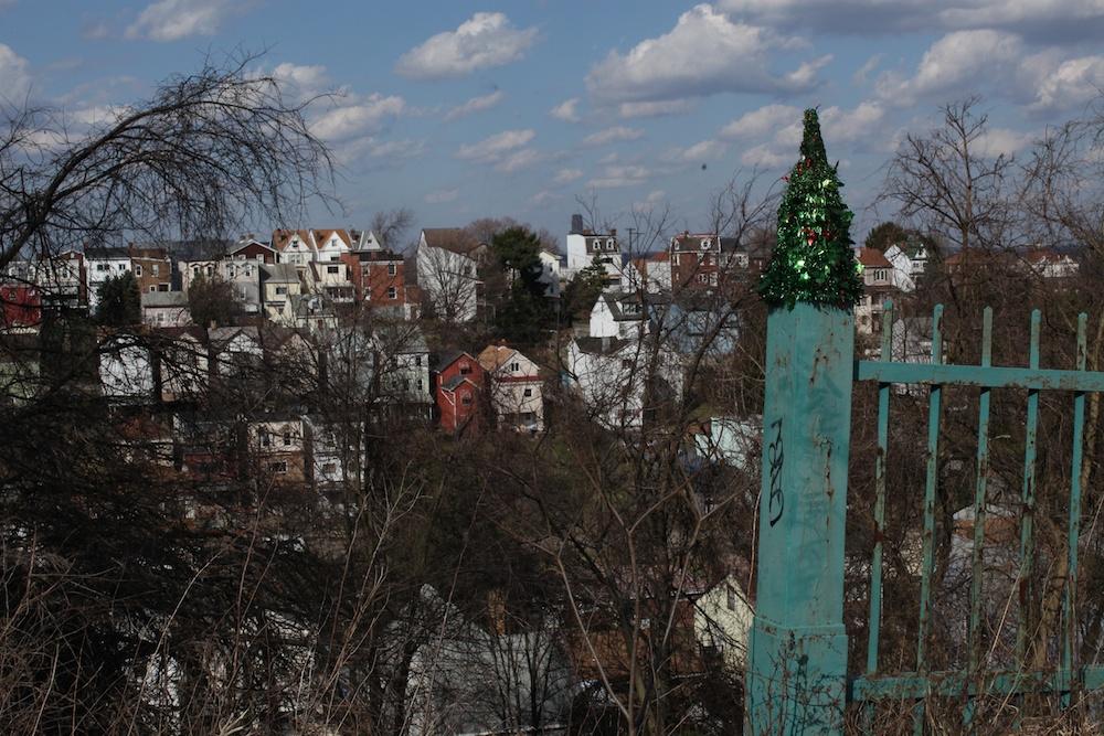 xmas tree atop fence