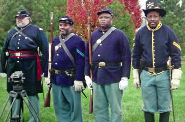 Dr. George Smith (second from left) is a re-enactor in the 13th U.S. Colored Troo[ps regiment, a local historian, was shocked to find Sherrod Bryant, a freed slave who owned slaves in Rutherford Count (File photo)