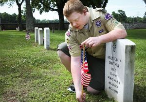 Ever since he was a Tiger Cub, John Thomas Glasner, a junior at Stewarts Creek High School, has placed a flag every year at the grave of his great-great-uncle, Houston Smythia. Saturday morning Glasner joined hundreds of scouts and interested park visitors to place flags at all the graves. (Photo: Tom Beckwith/DNJ)