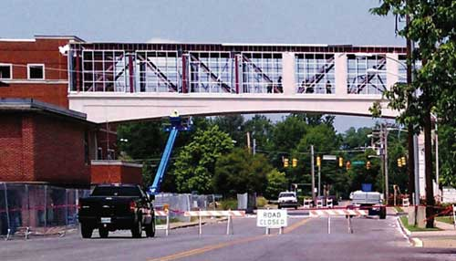 Demolition crews work to remove the pedestrin bridge over Bell Street. (Courtesy WGNS)