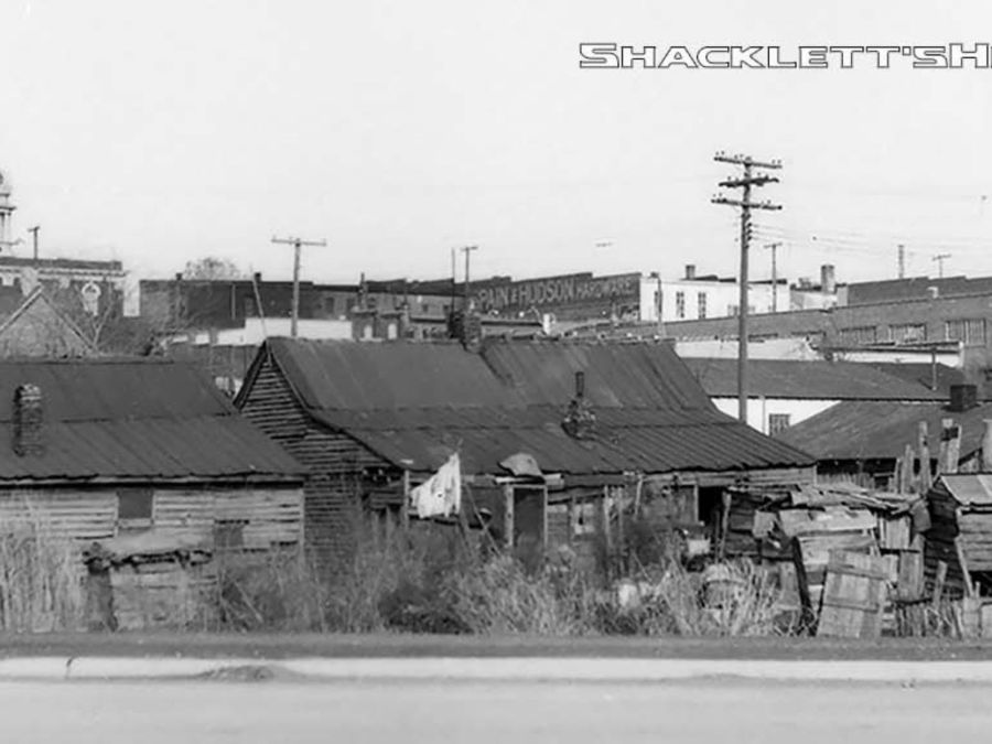 The Bottoms, once located south of the historic Public Square in Murfreesboro, was prone to flooding. During Urban Renewal, families were moved out to make way for what is now Broad Street. The 'shantytown' was constructed of any materials the low-income residents could find.  Shacklett's Photography