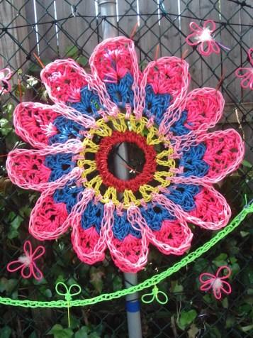 crocheted flower with metal hoop