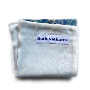 cream/Blue pocket square with white and green abstract pattern