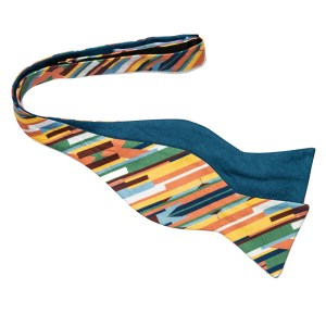 untied bow tie in a brightly colored stripe on the bias