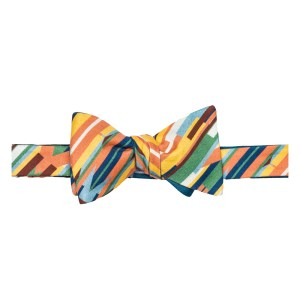 tied bow tie in a brightly colored stripe on the bias