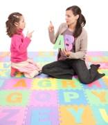 Girl learning phonics alphabet abc