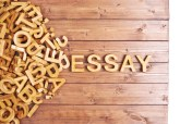 Word essay made with wooden letters