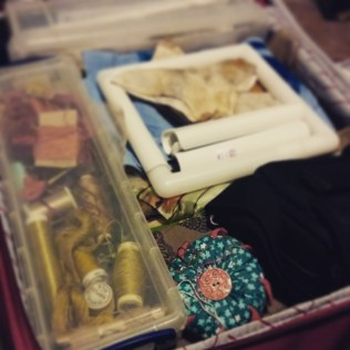 Suitcase packed ready for the trip. Ruth Singer Narrative Threads