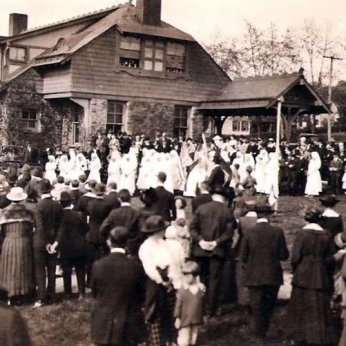 Ruxton Railroad station in what appears to be a World War I sendoff or welcome back for nurses. Not a wedding, too many bridesmaids.