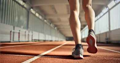 fit athlete during training on running track