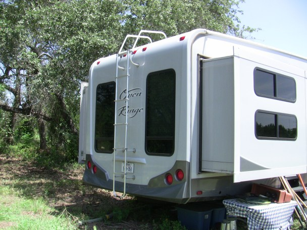 rv rear view showing running lights and ladder