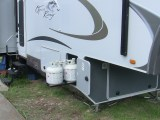 RV Propane Bottles and Storage Passenger Side View