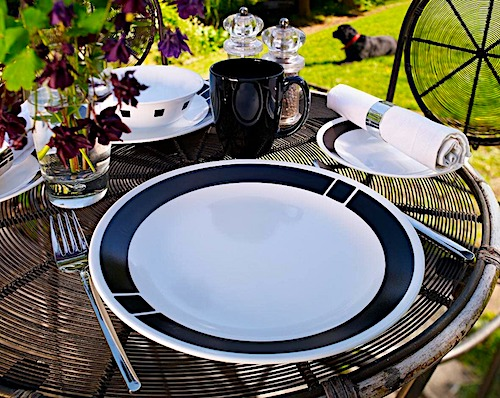 black and white corell dish set on a table outside