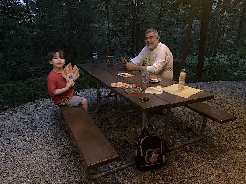 Play cards at night when camping