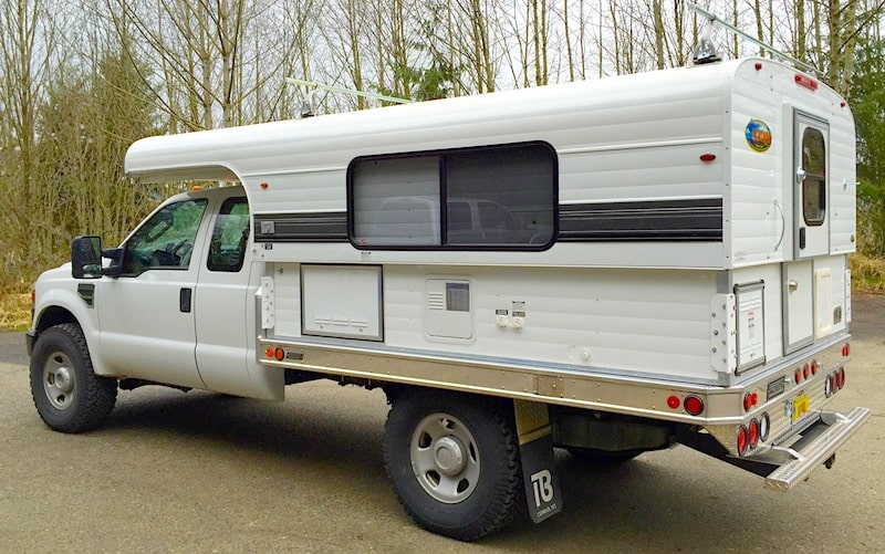 Alaskan flat bed truck camper