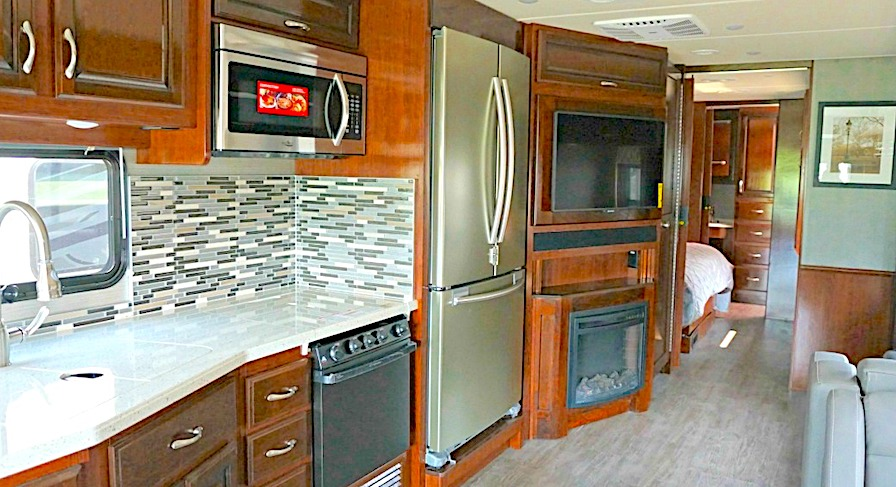 RV with a residential fridge in the kitchen