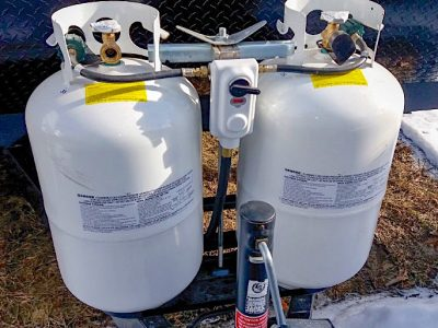 Two propane tanks at the front of a travel trailer