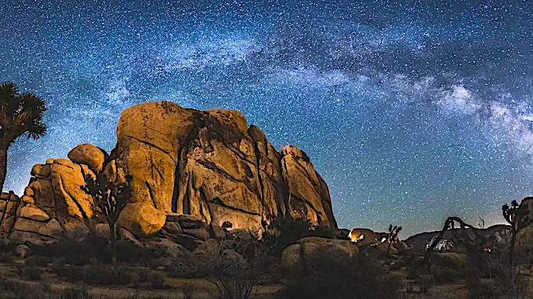 Rock formation under the milky way galaxy at night in Joshua Tree National Park