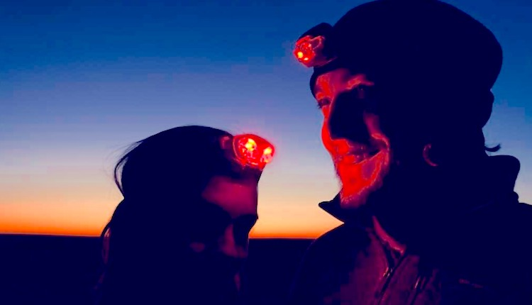 People with red headlamps on while stargazing at Indian Cove Campground in Joshua Tree National Park