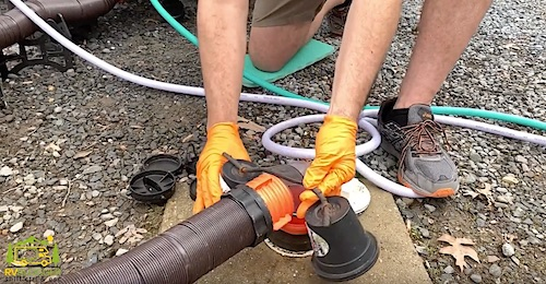 RV Sewer Hose Plasitc Bell shaped weights holding RV sewer hose in place