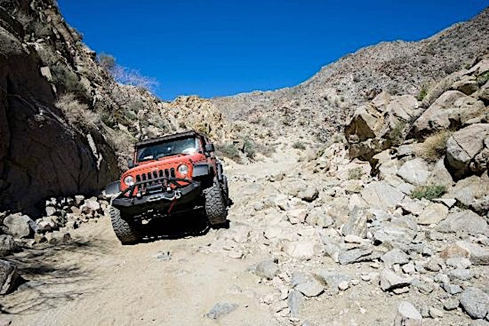 jeep driving through rocks on geology trail tour at Joshua Tree
