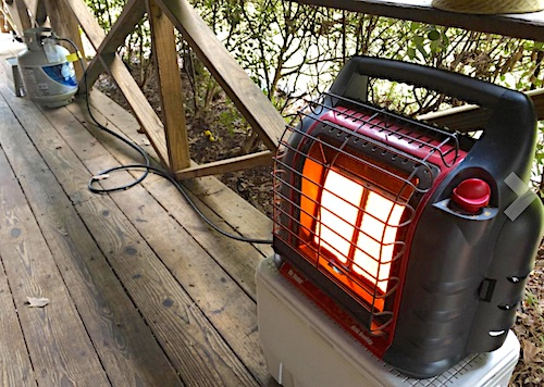 Propane heater with adapter connected to 20 gallon propane tank