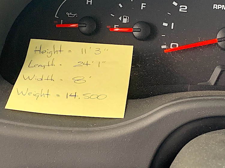 post it note on RV dashboard showing height weight length and width