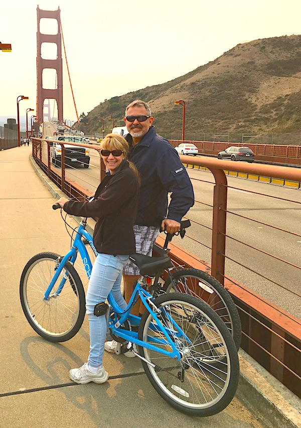 Mike and Susan on bikes at Golden gate bridge