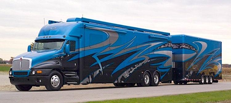 Super C RV motorhome towing a trailer