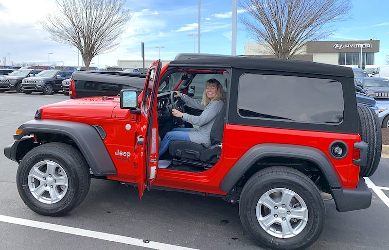 Susan in our new jeep that can be flat towed behind our RV