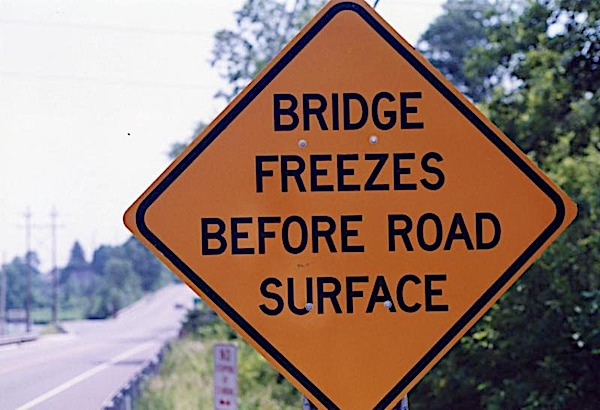 bridge freezes before roadsign