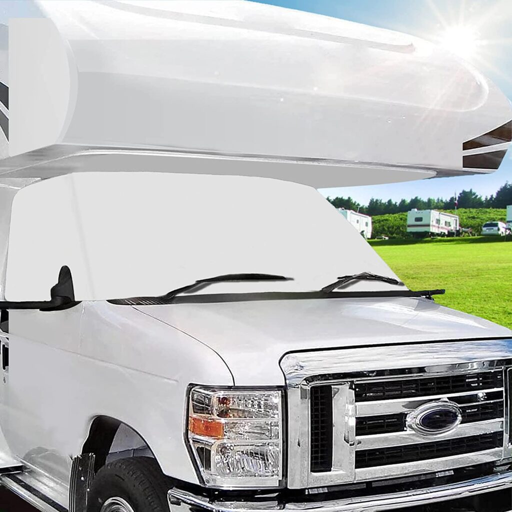 White window cover on front windshield of RV