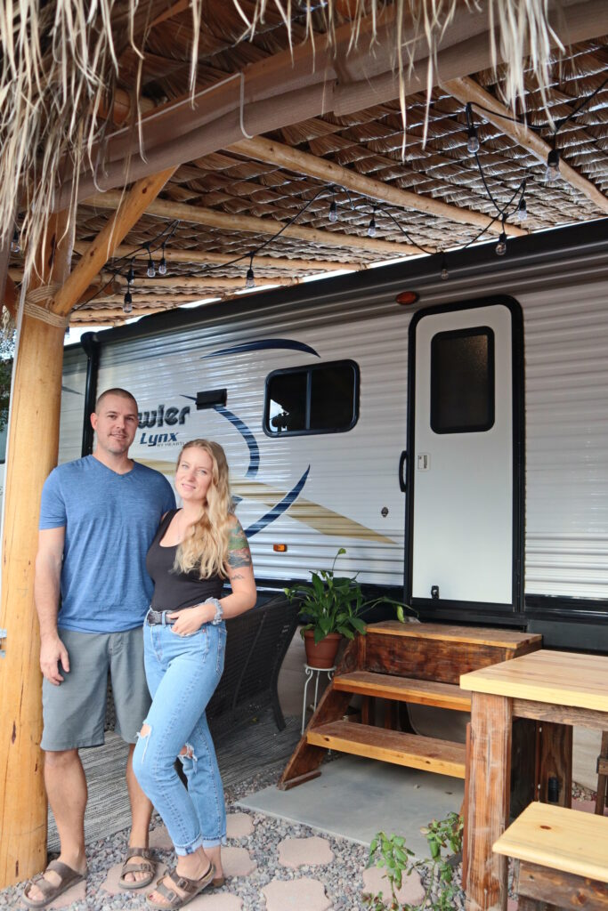Young couple posing outside of an RV in Mexico
