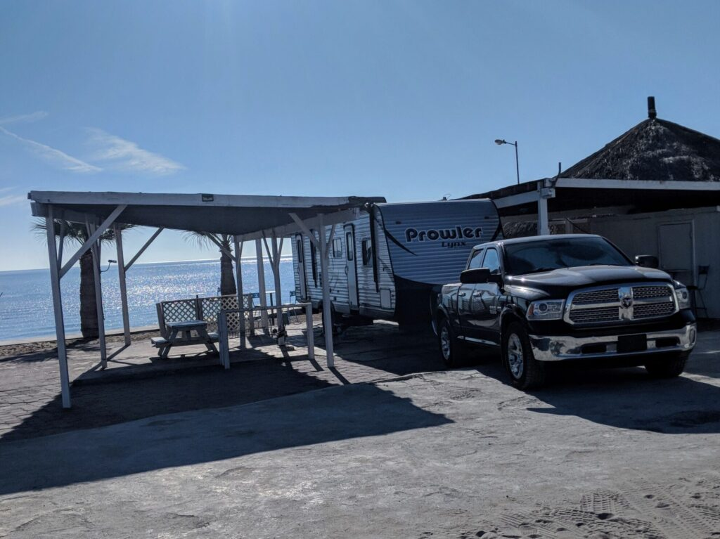 Truck and RV parked in RV park beside the ocean in Mexico