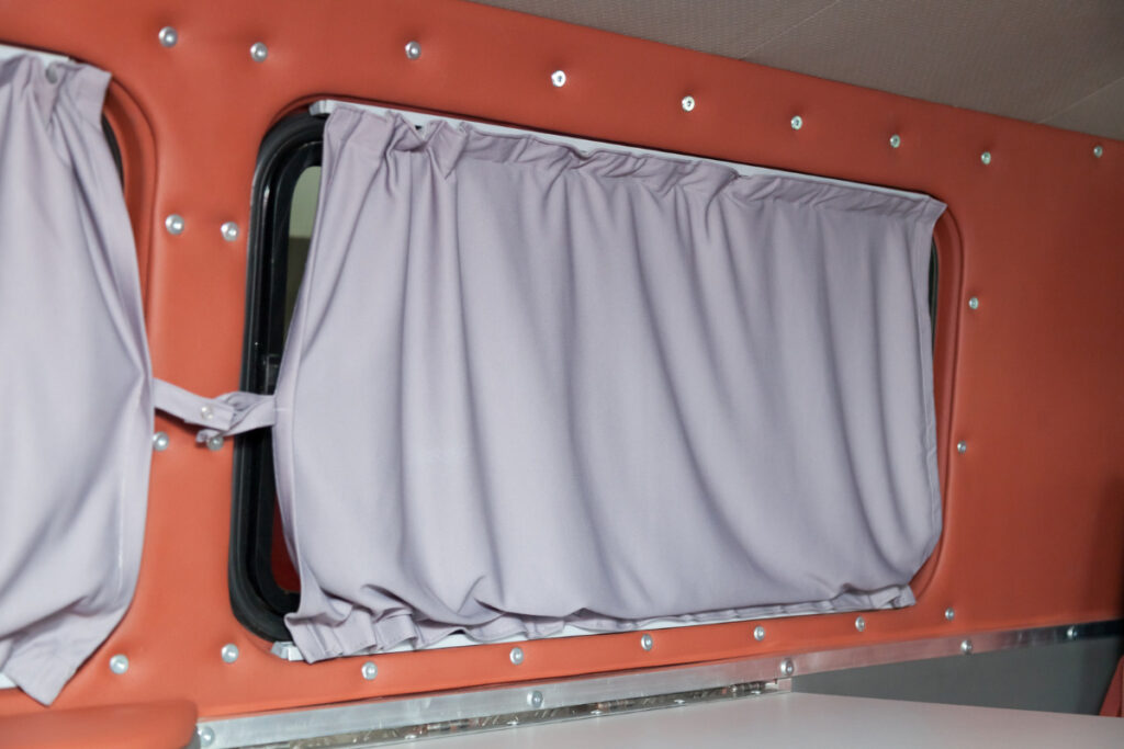 Fabric curtains hanging in a van window
