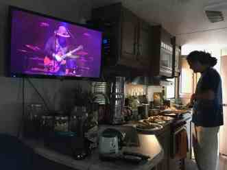 Tony Cooking in the RV while watching a concert