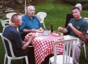 Ingo Swann (L), Lyn Buchanan, and the author's son, James at the Puthoff's dinner party during the 2002 Remote Viewing Conference