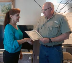 Russian remote viewing student Marina receiving her diploma