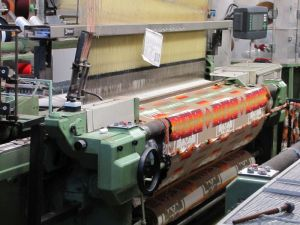 A mechanized loom producing blanket fabric in the Pendleton Woolen Mills