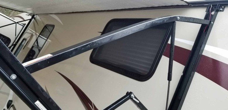 RV awning support arm bent.